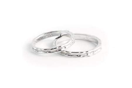 two white gold rings stacked together on white background photo