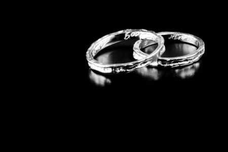 two white gold rings stacked together on black background Stock Photo - 13678102