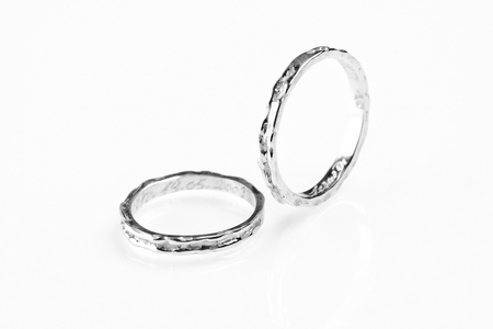 two white gold rings on white background photo