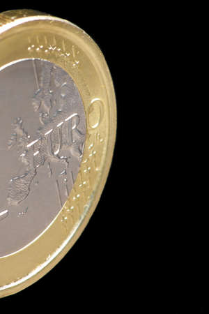 One euro coin isolated on black background Stock Photo - 13993195