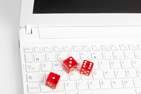 a computer keyboard with three red dice