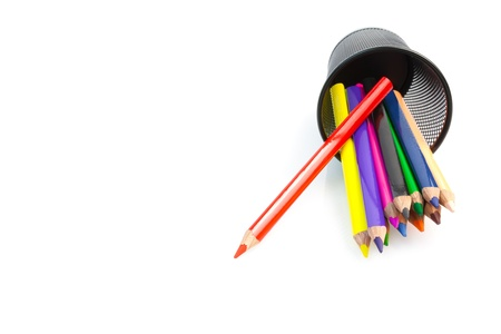 color pencils and container on white background photo