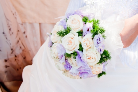 detail of wedding bouquet at bride photo