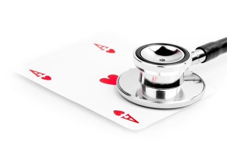 playing card near a stethoscope on the white table Stock Photo - 15386576