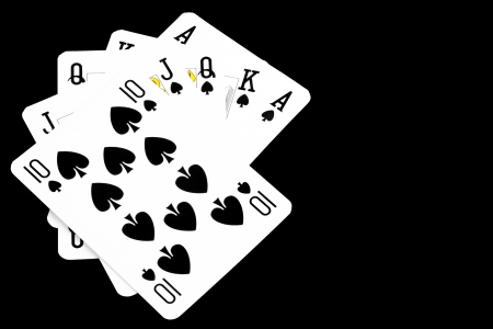 winning royal flush hand on black background photo