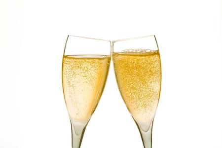 Acclamations, deux verres de champagne avec des bulles d'or sur fond blanc Banque d'images - 16902179