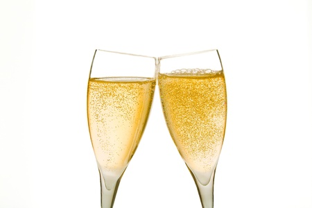 cheers, two champagne glasses with gold bubbles on white background