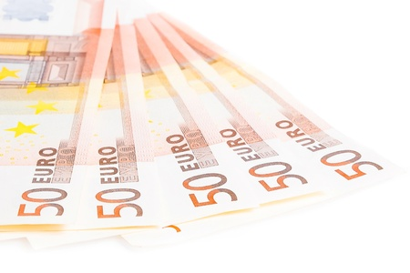 european economic community: crisis of eurozone, detail of some 50-euro banknotes on white background Stock Photo