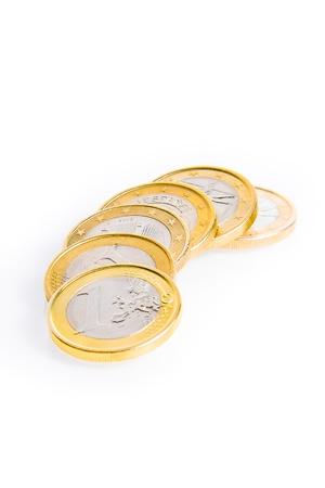 eurozone: crisis of eurozone, detail of some euro coins on white background Stock Photo
