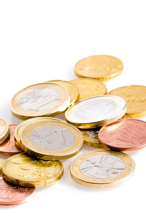 european economic community: a lot of euro coins on white background