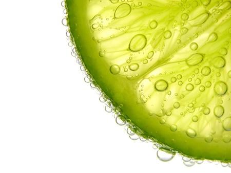 closeup a half lime on white background Reklamní fotografie - 18334264