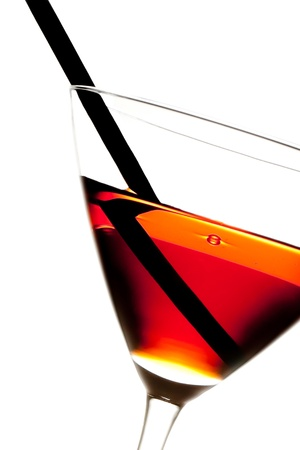 red cocktail with straw on white background photo