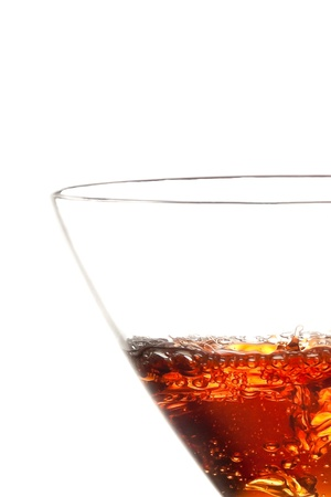 half glass with red cocktail on white background photo
