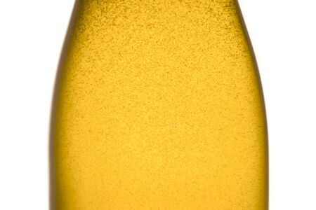 detail of champagne bottle with golden bubbles on white background photo