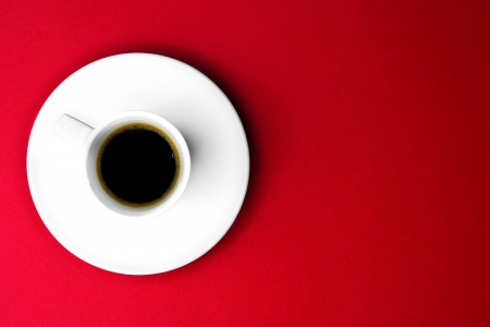 cup of coffee over the red background photo
