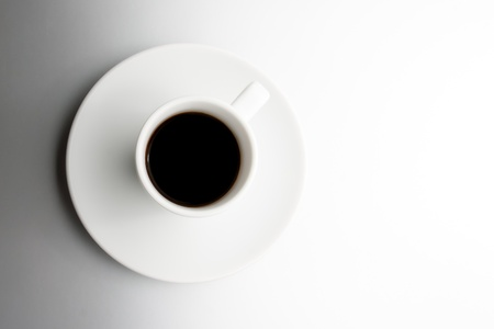 top view of cup of black coffee with space for text over the silver background photo