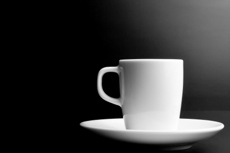 noire: white cup of coffee with space for text on noire background Stock Photo