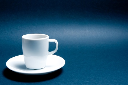macro: cup of coffee with space for text over the blue background Stock Photo