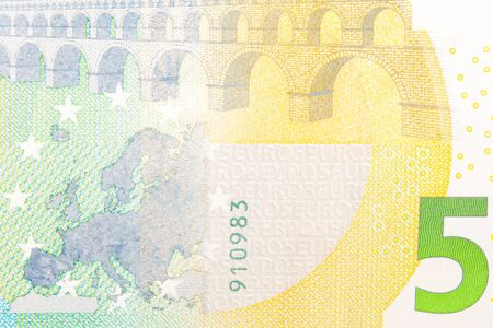 detail of new five euro banknote back side photo