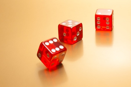 detail of three red dice on golden background  photo