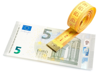 roll of measuring tape on new five euro banknote on white background