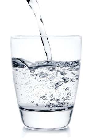 filling a glass with pouring water on white background