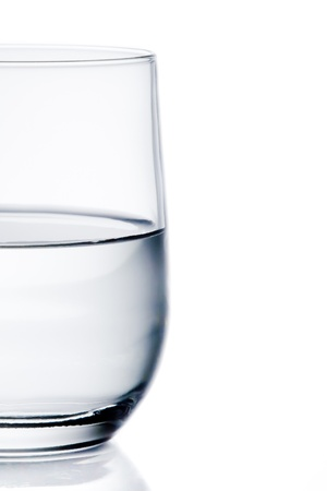 half glass of pure water with space for text on white background