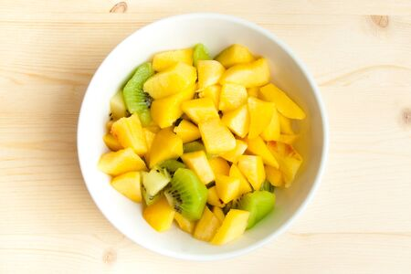 diet, healthy fruit salad in the white bowl - healthy breakfast, weight loss concept photo