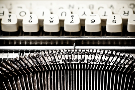 detail of type bars and white buttons of typewriter photo