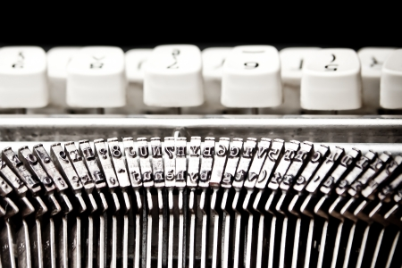 typewriter machine: detail of type bars and white buttons of typewriter on black background Stock Photo