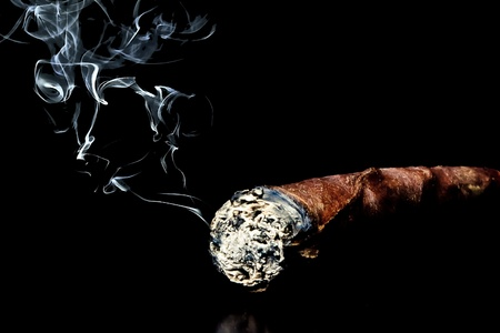 cigar with smoke with space for text over black background