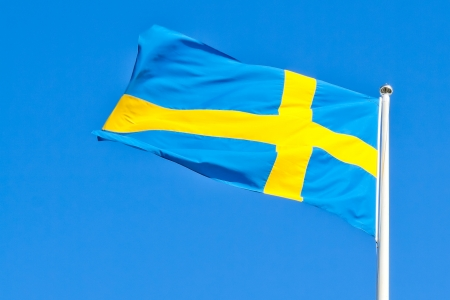 swedish flag without cloud against blue sky Stock Photo