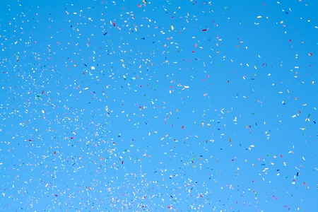 poppers: colored confetti flying in the blue sky