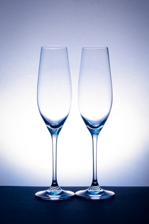 empty champagne glass on blue spot background photo