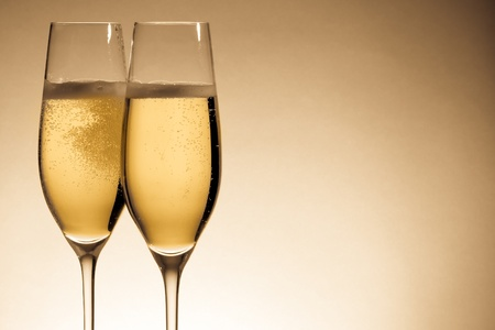 flutes: two glasses of champagne with golden bubbles and space for text Stock Photo
