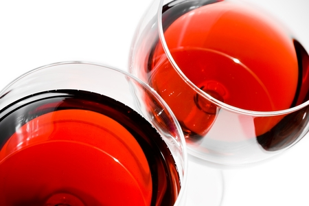 top of view of two red wine glasses on white background photo