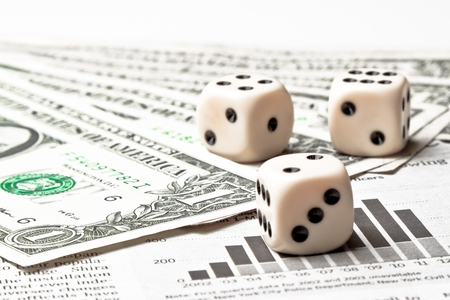 dice on financial chart near dollars on white table photo