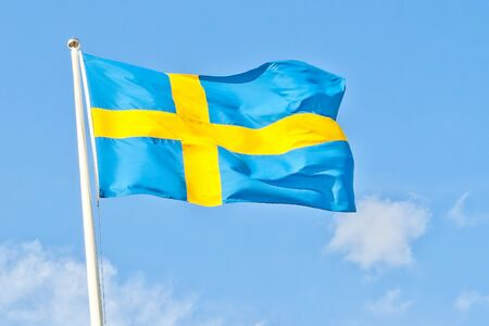 swedish flag against blue sky photo