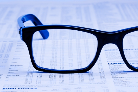 stock quotations: glasses over financial newspaper Stock Photo