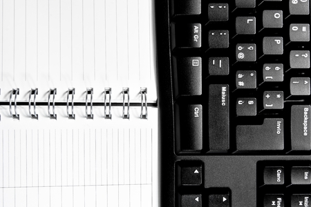 top of view of a notebook and keyboard photo