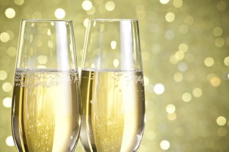 flutes of champagne on golden bokeh background photo