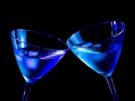 cin: two glasses of  fresh cocktail with ice make cheers on blue tint light with space for text Stock Photo