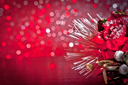 christmas decoration on red bokeh background with space for text photo