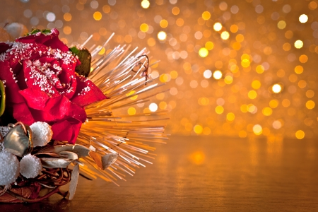 christmas decoration on golden bokeh background with space for text photo