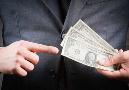 corruptible: detail of businessman with dollars in his hand, concept for business and earn money Stock Photo