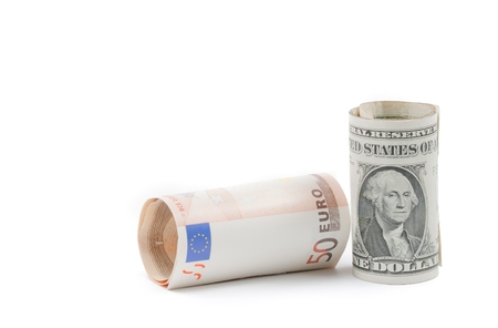 rolled up euro and rolled up dollars banknote on white background with space for text, concept for business and save money photo