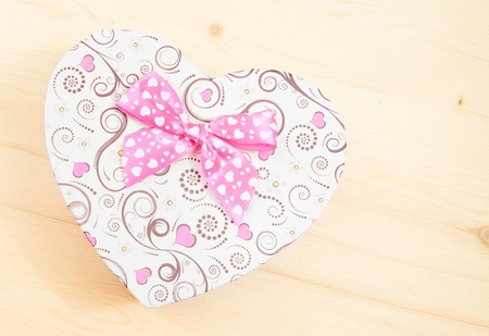 heart shaped stuff: valentine day gift with ribbon on wood table with space for text