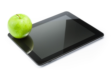 green apple on digital tablet pc on white background photo