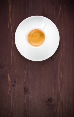 top of view of one cup of italian espresso coffee on old wood table with space for text photo