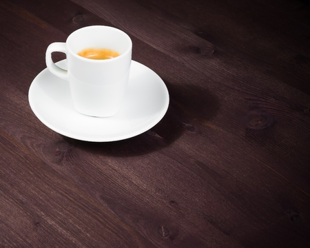cup of italian espresso coffee on old wood table with space for text photo